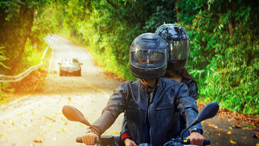 Two people on motorcycle