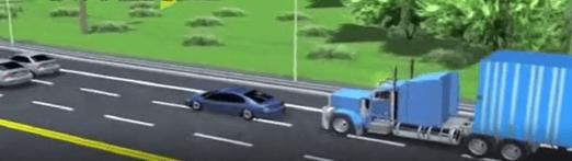 Blue truck driving behind blue car