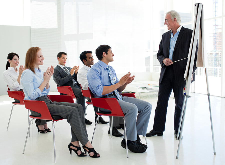 Business people applauding at the end of a conference in the office