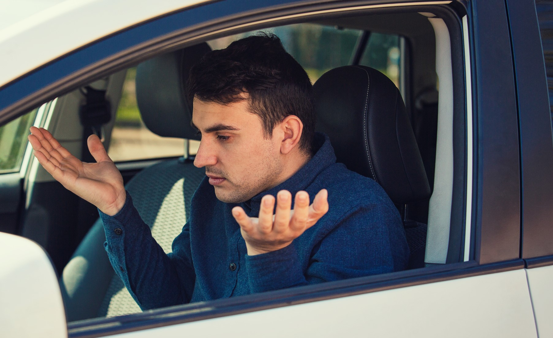 Frustrated man in driver's seat of car